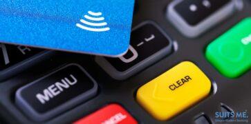 Contactless payment - blue debit card on transaction terminal