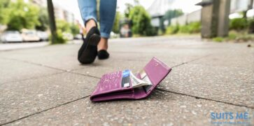 Woman Walking Away Without Realising She's Lost Her Wallet With Money and Bank Cards