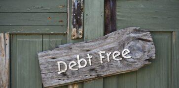 Debt free sign on green door