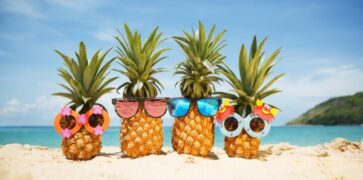 Pineapples on a Beach with Sunglasses