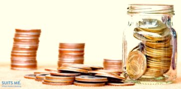 Bronze and Gold Coins in a Jar with White Background - Representing Saving Money