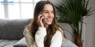 relieved millennial having pleasant conversation chatting by mobile with creditors who can help with debt