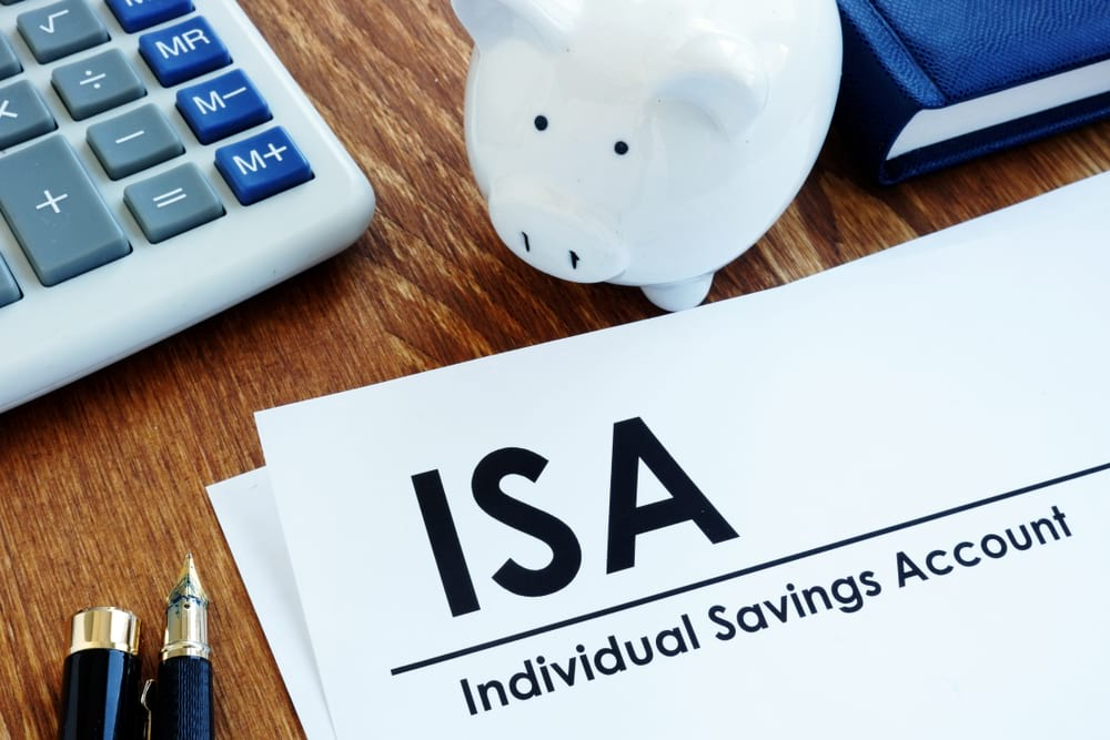 ISA document with a piggy bank next to it