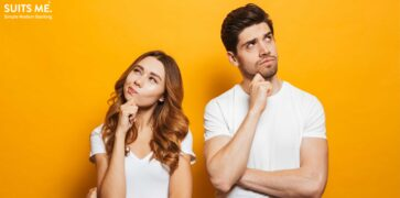 happy young people man and woman in basic clothing thinking about direct debits and standing orders whilst touching chin and looking aside over yellow background