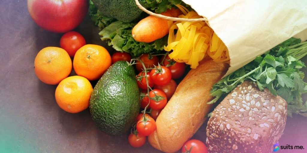 Image of grocery shopping bag on the floor with fresh produce and groceries inside