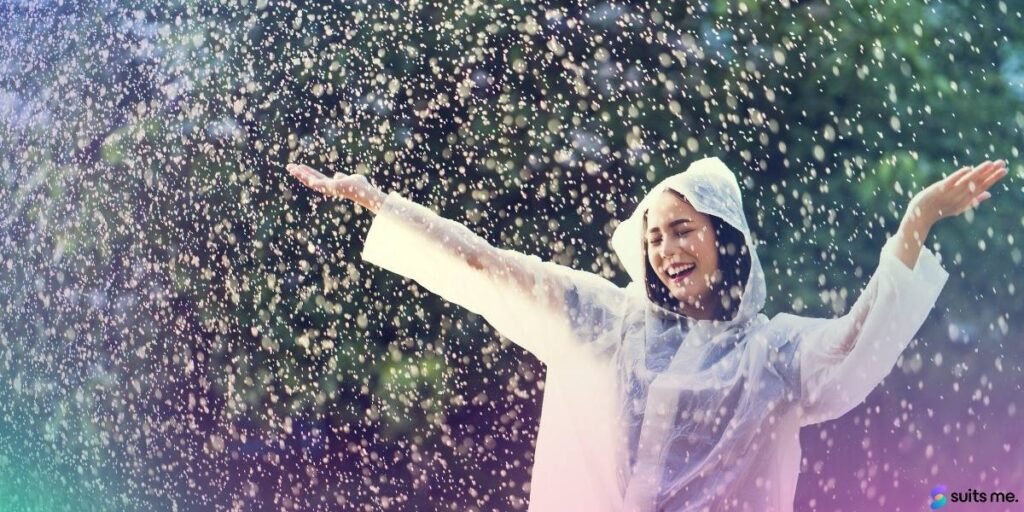 Woman in a White Coat, Dancing in the Rain Because She's Started a Rainy Day Fund to Achieve Financial Wellness