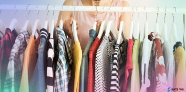 Woman Looking Through her Capsule Wardrobe with Clothes Hung on a Clothing Rail