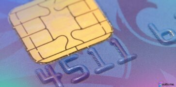 Macro shot of a blue prepaid debit card with a colourful gradient overlay
