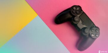 Video game controller on a yellow, blue and pink background