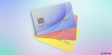 Three different coloured prepaid cards on a white background