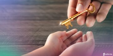 Adult passing a key down to a child - generational wealth concept