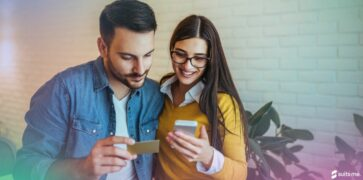 Couple happy because they've been able to build their credit score quickly to open a new account