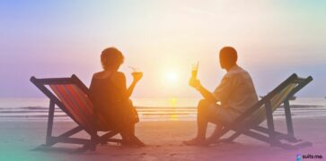 Couple being able to enjoy their holiday on the beach after saving money for it