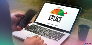 Person checking their credit score on a laptop
